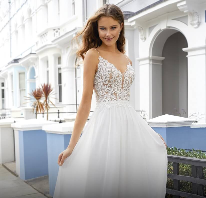 Model wearing a white A-line Style Gown