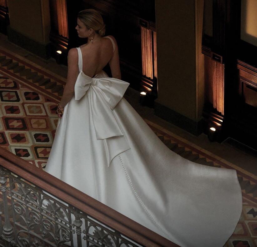Model wearing a white Ballgown Style Gown